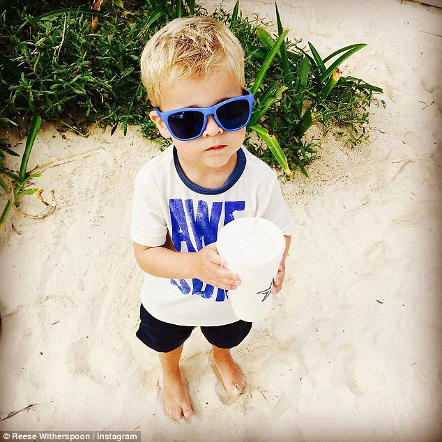 '3 is a magic number': The 39-year-old took a photo of the birthday boy, as he stood barefoot in the sand