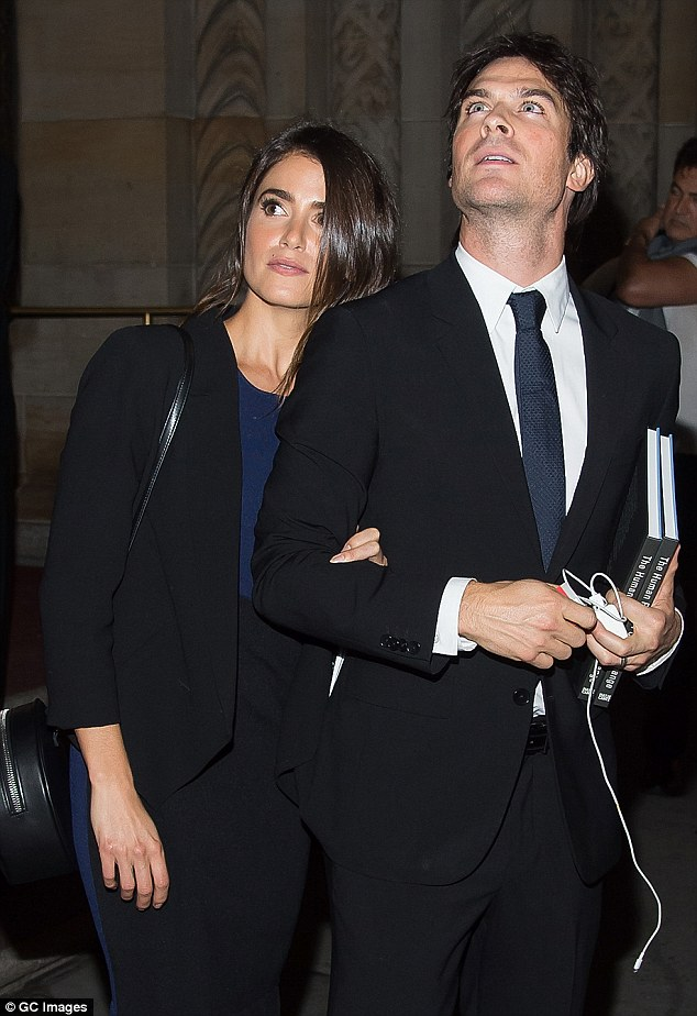 Good looking couple: Ian, 36, looked sharp in a dark suit and carried a couple of books with him