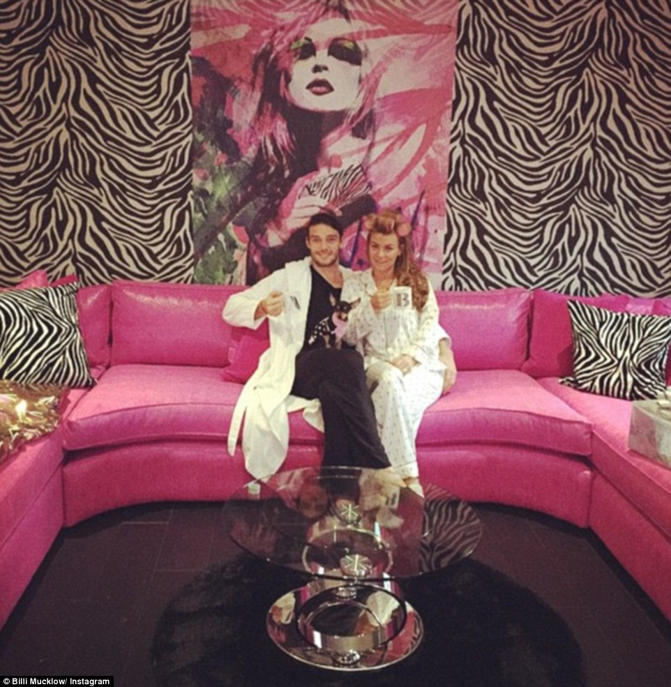 Mucklow and Carroll's interior decor choices at 'Carroll Castle' include bright pink leather sofas and zebra-print cushions and wallpaper