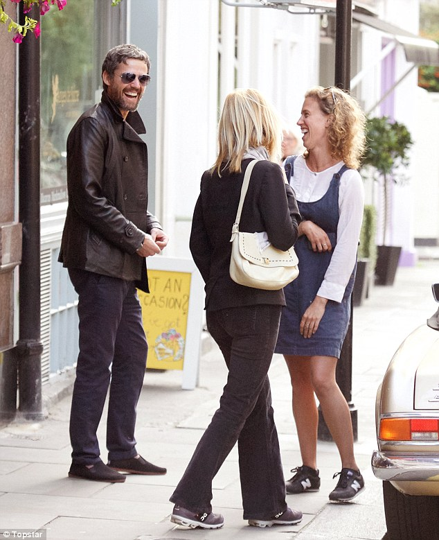 Being friendly: The 45-year-old crooner, who left the chart-topping band a year ago last week,was later seen chatting to some women, who appeared slightly awestruck when they recognised the star