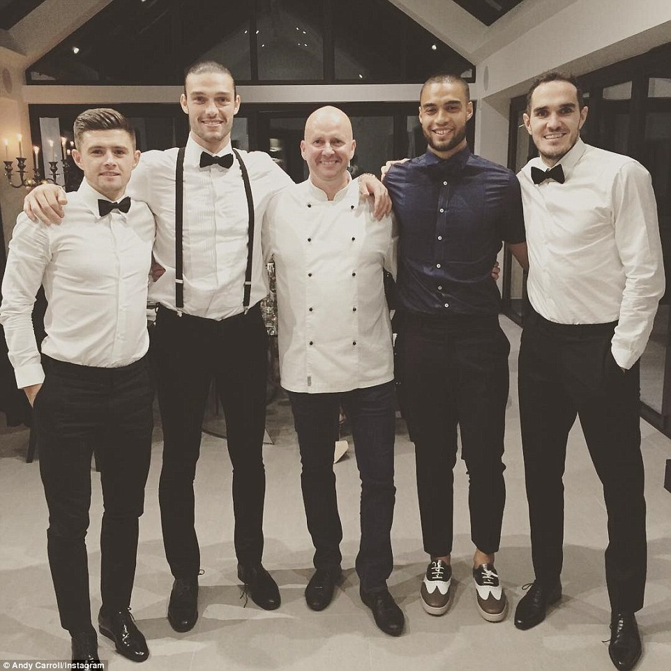 West Ham striker Andy Carroll (second left) shared a picture on Instagram after hosting  team-mates Aaron Cresswell (left), Winston Reid (second right) and Joey O'Brien (right) for dinner