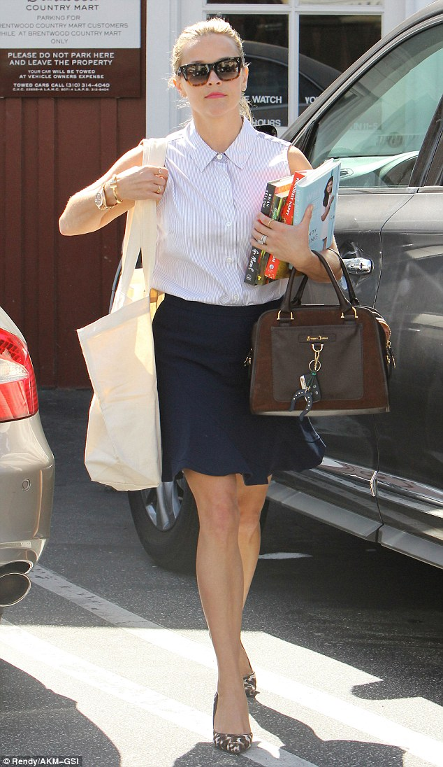 She means business! The actress was spotted in yet another outfit, clutching books in Brentwood on Friday