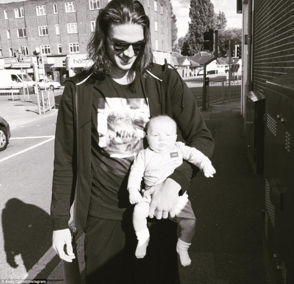 West Ham player Carroll and his fiancee Muklow have a baby son together called Arlo, who was born in June
