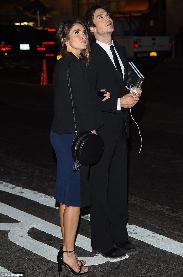 Under the moonlight: Nikki Reed and Ian Somerhalder were transfixed by the supermoon phenomenon on Sunday evening as they left an event in New York