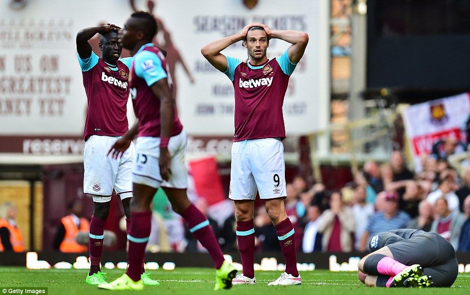 Carroll (centre) came on with West Ham trailing 2-1, but his side got a last-minute equaliser at Upton Park