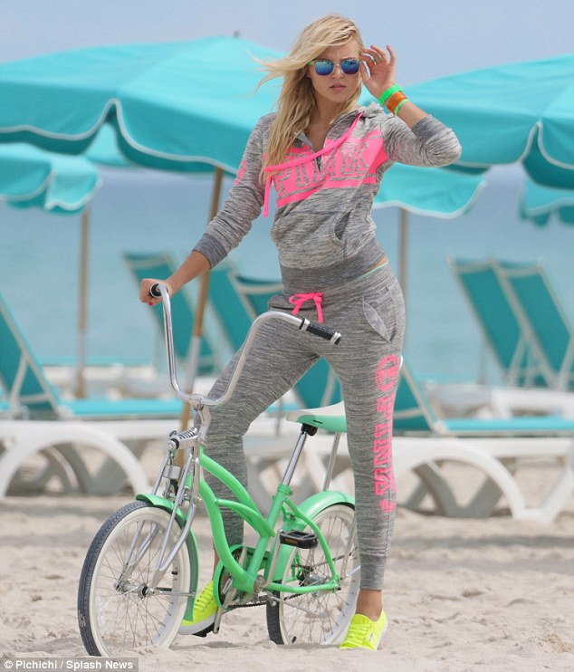 Cruising off: The looker also modelled for the line's lounge wear while standing over a mint green beach cruiser