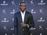 "MIAMI, FL - DECEMBER 06:  Olympic athlete Usain Bolt attends the Hublot opening of the Miami Design District ""Gallerie"" Boutique with Usain Bolt on December 6, 2014 in Miami, Florida.  (Photo by Ilya S. Savenok/Getty Images for Hublot)"