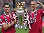 Manchester United's Cristiano Ronaldo (left) and Rio Ferdinand celebrate with the trophy following the FA Barclays Premiership match at Old Trafford, Manchester. PRESS ASSOCIATION Photo. Picture date: Sunday May 13, 2007. Photo credit should read: Martin Rickett/PA Wire.    THIS PICTURE CAN ONLY BE USED WITHIN THE CONTEXT OF AN EDITORIAL FEATURE. NO WEBSITE/INTERNET USE UNLESS SITE IS REGISTERED WITH FOOTBALL ASSOCIATION PREMIER LEAGUE.