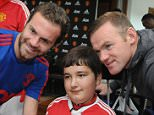 MANCHESTER, ENGLAND - SEPTEMBER 21:  Juan Mata and Wayne Rooney of Manchester United pose with Baris, 13, from Wigan, at the MU Foundation Dream Day, where poorly children meet the Manchester United team, at Aon Training Complex on September 21, 2015 in Manchester, England.  (Photo by Ian Cartwright/Man Utd via Getty Images)