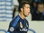 Real Madrid's Portuguese forward Cristiano Ronaldo celebrates after scoring the opening goal during the UEFA Champions League first-leg Group A football match between Malmo FF and Real Madrid CF at the Swedbank Stadion, in Malmo, Sweden on September 30, 2015.   AFP PHOTO / TT NEWS AGENCY / ANDERS WIKLUND    +++ SWEDEN OUT +++ANDERS WIKLUND,ANDERS WIKLUND//AFP/Getty Images
