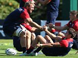 BAGSHOT, ENGLAND - SEPTEMBER 29:  Chris Robshaw (L) stretches with team mate Herny Slade during the England training session at Pennyhill Park on September 29, 2015 in Bagshot, England.  (Photo by David Rogers/Getty Images)