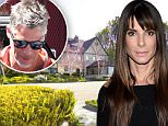 """Here's a first look inside Sandra Bullock's spectacular Beverly Hills mansion. The Oscar-winning actress, 46, purchased the stunning $23million dollar property as the perfect place to start afresh. There is plenty of space for 'The Blind Side' star and adopted son, Louis, in the seven-bedroom, eight bathroom pad. Bullock split from her unfaithful husband, Jesse James, in 2010 following revelations the motoring mogul had cheated on America's sweetheart. """"It will take her a year to remodel the mansion and get it just how she wants it,"""" an insider said of the purchase. """"It's a big project but when she's done it will be spectacular."""" The house offers panoramic views from downtown LA to the Pacific Ocean. The Tudor-style home also boasts massive windows for Sandra to admire the sprawling 4.1 acre grounds. The estate features its own private screening room, a master bedroom with dual bathrooms and a luxurious pool, where lucky Louis can learn to swim.....Pictured: Sandra Bullock's Beverly"""
