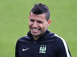 MANCHESTER, ENGLAND - SEPTEMBER 29:  Sergio Aguero smiles during a Manchester City training session ahead of their Champions League fixture against Borussia Moenchengladbach at City Football Academy on September 29, 2015 in Manchester, England.  (Photo by Jan Kruger/Getty Images)