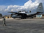 A U.S. Air Force C-130 Hercules aircraft sits in the on the tarmac after U.S. Army Pfc. Ardell D. Harris, a transportation management coordinator from St. Louis, assigned to 339th Movement Control Team, 1st Brigade Combat Team, 101st Airborne Division, Task Force Bastogne, loads it with supplies at Jalalabad Airfield, eastern Afghanistan's Nangarhar Province March 31. Jalalabad Airfield is an essential stop for equipment and troops being pushed out to the front lines for Operation Enduring Freedom.