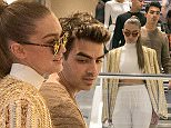 PARIS, FRANCE - OCTOBER 01:  (L-R) Gigi Hadid and Joe Jonas are seen shopping at the 'COLETTE' store on October 1, 2015 in Paris, France.  (Photo by Marc Piasecki/GC Images)