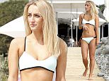 MUST BYLINE: EROTEME.CO.UK Made in Chelsea's Tiffany Watson shows off her incredible bikini body in a mint blue bikini while on holiday with former cast member and blogger Aurelie Mason Perez @wearedoubletroubleofficial.  Despite cheating rumours on her boyfriend Sam Thompson and potentially single Tiffany seemed carefree as she enjoyed a bottle of lager at the famous Blue Marlin 'it' spot before being caught in the rain. EXCLUSIVE  September 30, 2015 Job: 150930L2    Ibiza, Spain EROTEME.CO.UK 44 207 431 1598 Ref: 341629