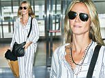 EXCLUSIVE TO INF.\nOctober 1, 2015: Heidi Klum is seen make-up free as she jets off from JFK airport in New York City. Mandatory Credit: PapJuice/INFphoto.com Ref: infusny-285