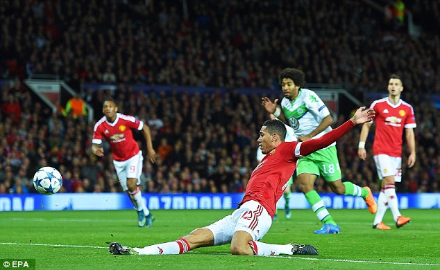 United centre-back Chris Smalling stabs home the winner in a 2-1 victory over Wolfsburg at Old Trafford