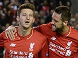 Liverpool's English midfielder Adam Lallana (L) celebrates with Liverpool's English striker Danny Ings after scoring the opening goal of UEFA Europa League group B football match between Liverpool and FC Sion at Anfield in Liverpool, north west England on October 1, 2015. AFP PHOTO / OLI SCARFFOLI SCARFF/AFP/Getty Images