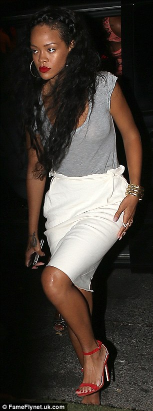 Sophisticated songstress: The 24-year-old was pictured clutching her phone as she left the club