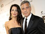 George Clooney (R) and Amal Alamuddin attend the Celebrity Fight Night gala celebrating Celebrity Fight Night In Italy benefitting The Andrea Bocelli Foundation and The Muhammad Ali Parkinson Center on September 7, 2014 in Florence, Italy.  (Photo by Rachel Murray/Getty Images for Celebrity Fight Night)