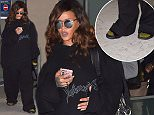 Rihanna is seen arriving in paris at charles de Gaulle airport for fashion week  Pictured: Rihanna Ref: SPL1140603  011015   Picture by: Neil Warner / Splash News  Splash News and Pictures Los Angeles: 310-821-2666 New York: 212-619-2666 London: 870-934-2666 photodesk@splashnews.com