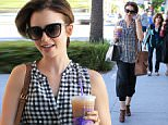 Beverly Hills, CA - Lily Collins is in a good mood as she shops in Beverly Hills wearing comfy pants paired with a sheer gingham top. The actress and daughter of Phil Collins sips on an iced coffee in the Los Angeles heat. \nAKM-GSI      October  1, 2015\nTo License These Photos, Please Contact :\nSteve Ginsburg\n(310) 505-8447\n(323) 423-9397\nsteve@akmgsi.com\nsales@akmgsi.com\nor\nMaria Buda\n(917) 242-1505\nmbuda@akmgsi.com\nginsburgspalyinc@gmail.com