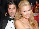 CAP D'ANTIBES, FRANCE - MAY 22:  Brandon Davis (L) and Paris Hilton attend amfAR's 21st Cinema Against AIDS Gala presented by WORLDVIEW, BOLD FILMS, and BVLGARI at Hotel du Cap-Eden-Roc on May 22, 2014 in Cap d'Antibes, France.  (Photo by Dave M. Benett/amfAR14/WireImage)