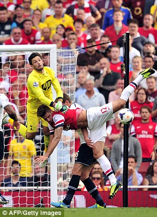 Friendly rivalry: Lloris upends Giroud during the North London derby in September last year