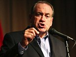 Mike Huckabee, a republican presidential candidate, gestures as he speaks on stage Thursday, Oct. 1, 2015 in Florence, Ala. Florence was Huckabee's first stop on his campaign day in Alabama. He also visited Sylacauga, Selma and Dothan. (Allison Carter/The TimesDaily via AP)