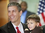 CHICAGO - DECEMBER 16:  President-elect Barack Obama (R) stands with Arne Duncan (L), the chief executive officer of Chicago Public Schools, and his four-year-old son Ryan after Duncan was introduced as Obama's choice for education secretary during a press conference at Dodge Renaissance Academy December 16, 2008 in Chicago, Illinois. Obama and Duncan are friends, neighbors and Harvard alumni.  (Photo by Scott Olson/Getty Images) *** Local Caption *** Ryan Duncan;Arne Duncan;Barack Obama