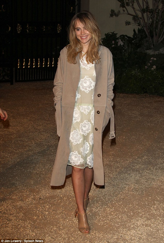 Still single? The blonde beauty looked gorgeous in a muted palette of caramel colours, including a signature trench coat