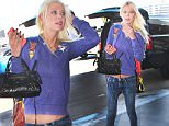Los Angeles, CA - Actress Tara Reid looks excited to depart for her flight as she is seen getting out of her vehicle at LAX. The slim blonde beauty wore a bright purple sweater paired with skinny jeans as she lugged her Louis Vuitton luggage to baggage check-in.\nAKM-GSI       October 2, 2015\nTo License These Photos, Please Contact :\nSteve Ginsburg\n(310) 505-8447\n(323) 423-9397\nsteve@akmgsi.com\nsales@akmgsi.com\nor\nMaria Buda\n(917) 242-1505\nmbuda@akmgsi.com\nginsburgspalyinc@gmail.com