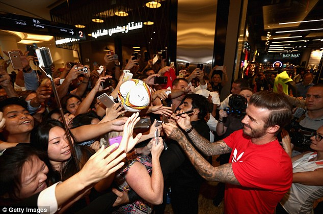 Beckham delights thousands of fans at the Mall of the Emirates on Tuesday at a new HomeCourt store