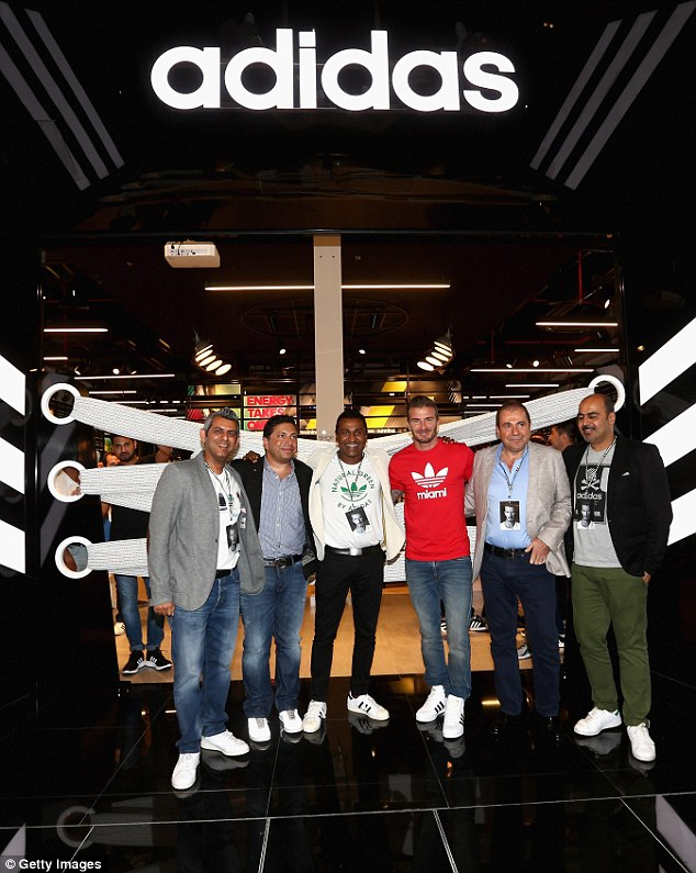 Looks the part: The star posed in his Adidas t-shirt, emblazoned with the location Miami, where the former footballer has plans to start a Major League Soccer team