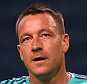 John Terry of Chelsea salutes the away fans as he warms down after being an unused substitute during the UEFA Champions League Group G match between FC Porto and Chelsea played at Estadio Do Dragao, Porto