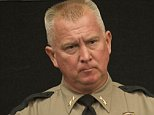 Mandatory Credit: Photo by Robin Loznak/REX Shutterstock (5212510m)  Douglas County Sheriff JOHN HANLIN, center, speaks to the media in Roseburg the day after  a shooter killed nine people on the campus of Umpqua Community College.  Shooting at Umpqua College, Roseburg, America - 02 Oct 2015