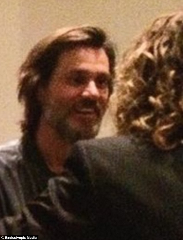 At the party, which started just two hours after White's ominous last tweet was posted, Carrey appeared untroubled, smiling and in deep conversation with another attendee at the party