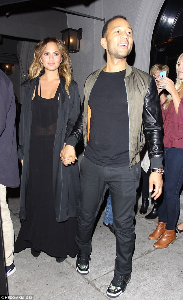Hand-in-hand: Chrissy Teigen and John Legend put on a loving display as they leftCraig's restaurant in West Hollywood on Tuesday
