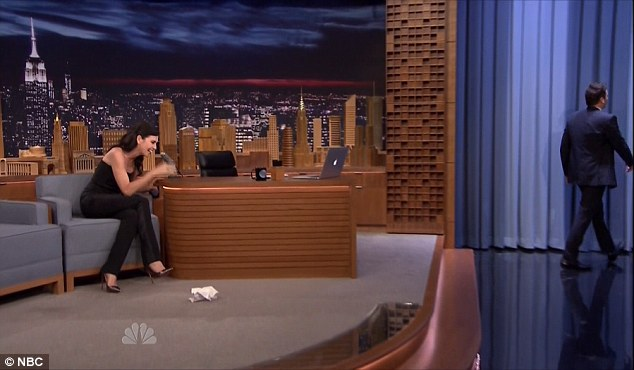 Walked away: Jimmy headed toward the exit as Julianna burst into laughter