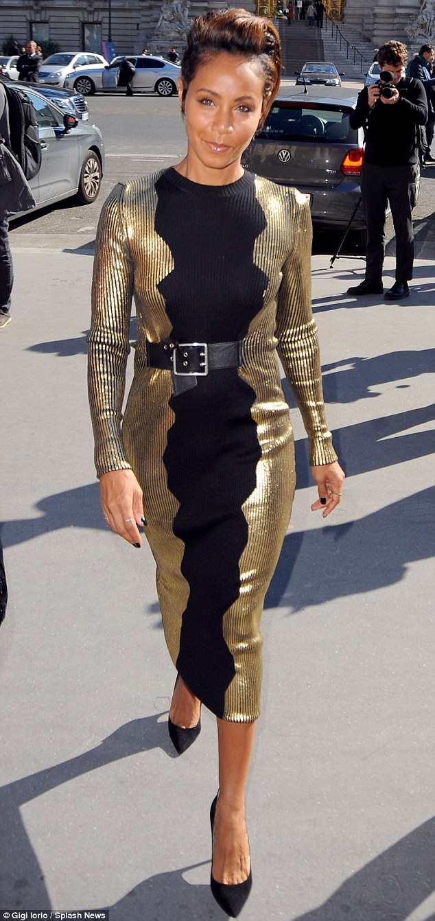 That's one way to shine: Jada Pinkett Smith  made a striking sartorial appearance at Paris Fashion Week on Wednesday when she slipped into a form-fitting pencil dress