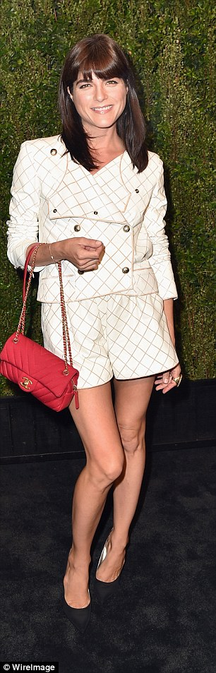 Cute outfit: The mum-of-one swung a Chanel handbag from her arm in a shorts suit
