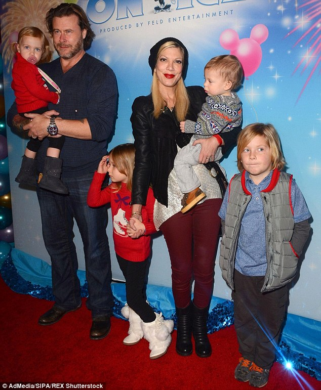 Mother of four: Tori is shown with husband Dean McDermott and their four children in December 2013 in Los Angeles