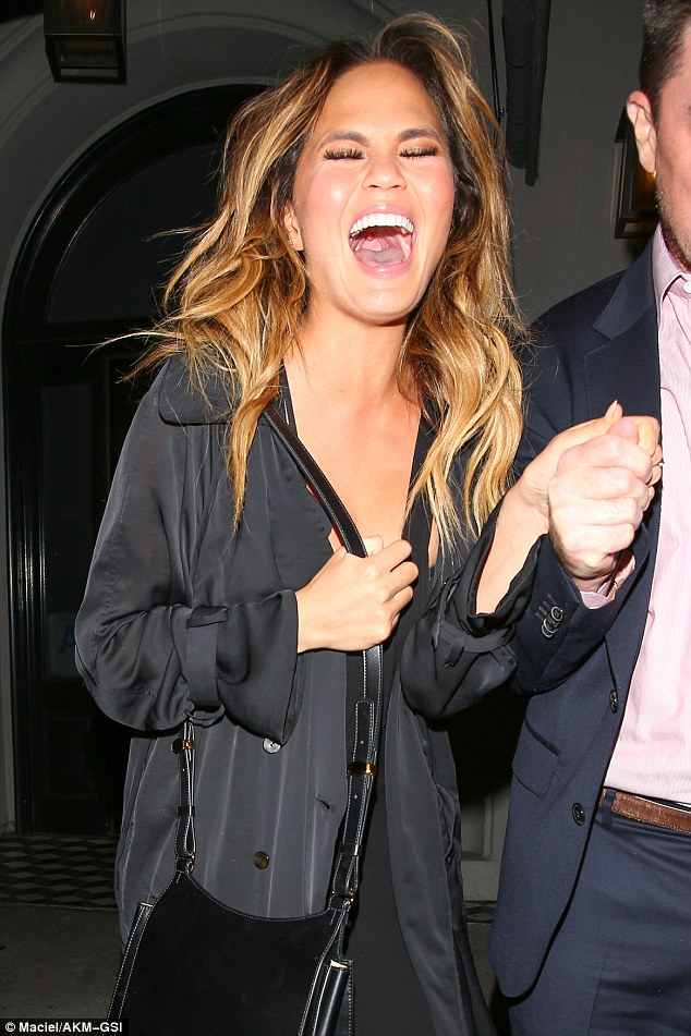 Loving life: Chrissy burst into peals of laughter as she left the venue following a four-hour dining session
