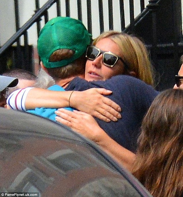 Friendly meeting: Chris and Gwyneth shared a tender embrace as they reunited for the actress's 43rd birthday brunch on Sunday at Prune in New York City