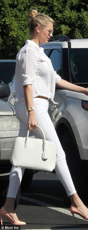 A bit of all-white: The Carl's Jr. model was dressed in all-white with skinny jeans, a button down top, and light coloured heels
