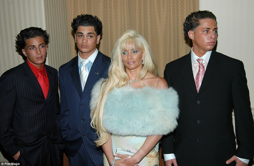 John Gotti Agnello (left) appeared on Growing Up Gotti with his brothers Frankie (second left) and Carmine (right). They are pictured here with their mother Victoria Gotti in 2004. The three teenage boys were well-known for their gelled-up hair styles and heavy fake tans