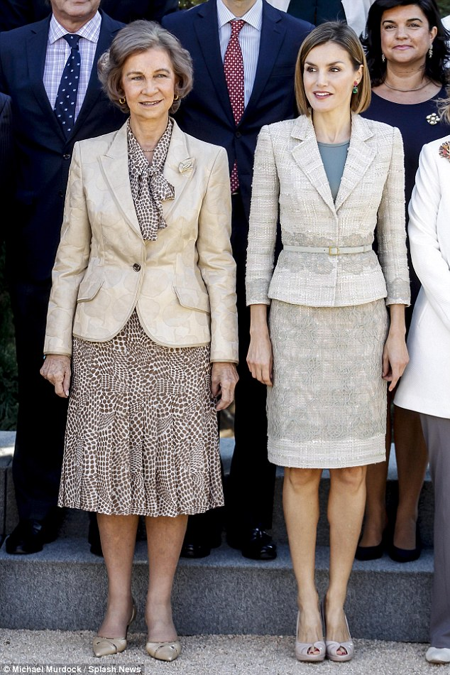 Queen Letizia and Queen Sofia wore matching beige to attend a meeting with members of foundation against drugs at Zarzuela palace in Madrid yesterday