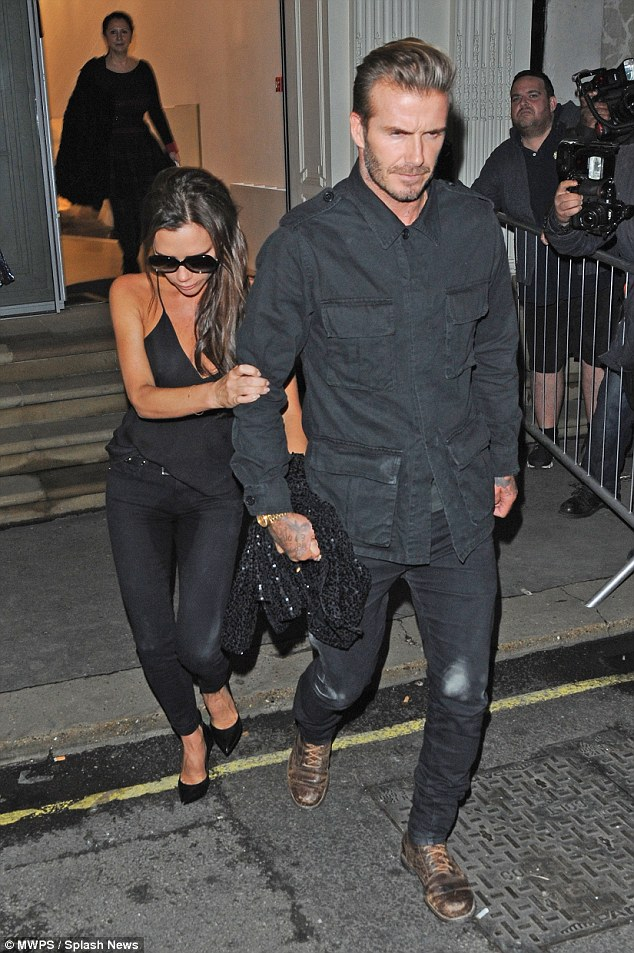 Party time: Last week, Victoria looked like she'd had a great time as she stumbled out of her London store's first anniversary party, clinging onto her husband as they went
