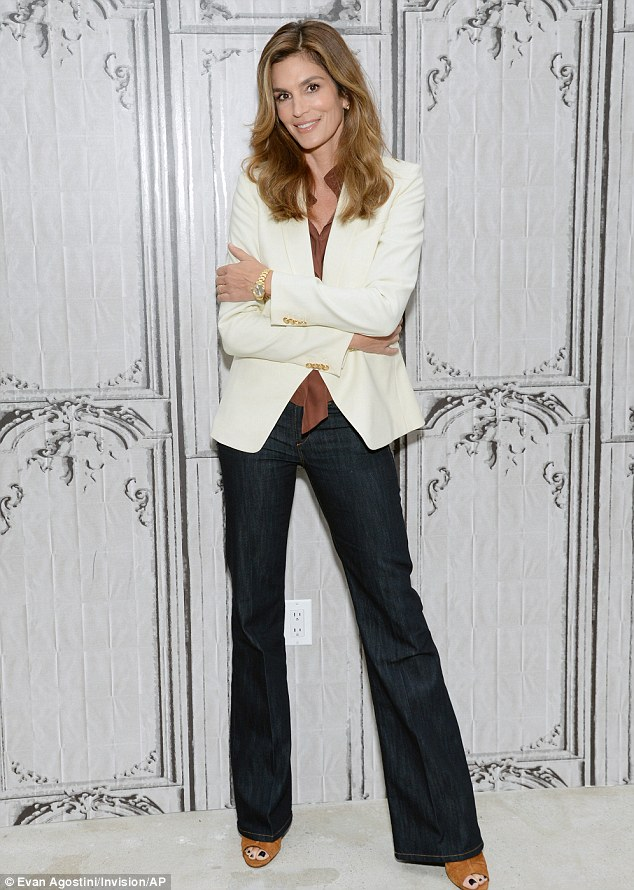 Smart casual: The natural beauty teamed bootleg jeans with a russet blouse and cream blazer
